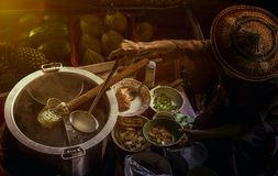 Thai noodle food making on floating boat in floating market thai royalty free stock image