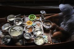 Thai noodle food style cooking in floating boat market royalty free stock photography