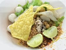 Thai noodle no soup serve with egg, lemon and pork ball and toppings with spicy. Thai street food. Stock Photography