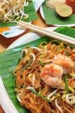 Thai noodle or padthai,garnish,vegetable,shrimp and blur backgro Royalty Free Stock Image