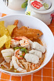 Thai noodle soup. Popular thai fusion food, Chinese-style rice noodles in sour spicy soup topped with seafood and vegetables Royalty Free Stock Photo