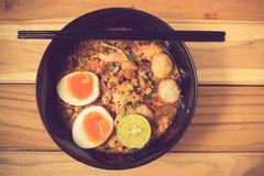 Thai noodle soup in a bowl taste spicy noodle soup Stock Photos