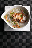 Thai Noodle Soup with Crispy Pork Royalty Free Stock Photo