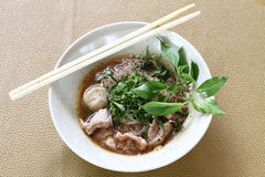 Thai noodle soup (Kuay Tiew Ruer). Serve with Basil, bean Sprout. Thai noodle soup . Serve with Basil, bean Sprout royalty free stock photography