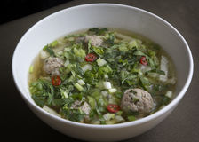 Thai noodle soup with meatballs. Chinese cabbage and cilantro Royalty Free Stock Image