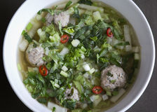 Thai noodle soup with meatballs. Chinese cabbage and cilantro Royalty Free Stock Photography