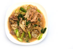 Thai noodle thick gravy call rad-na. Thai food noodle with pork and gravy soup in white background Stock Photo