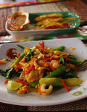 Thai noodle with vegetables and sea food. Thai spicy noodle with vegetables and sea food and chicken barbecue served in the street cafe royalty free stock photos