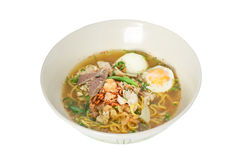 Thai noodle wich liver pork and Soft Boiled Egg. Hot and spicy tum-yum Thai noodle wich liver pork and Soft Boiled Egg Stock Photography