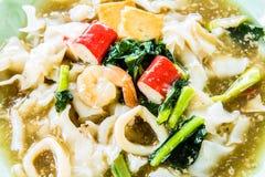 Thai noodles or kuaytio rat na, isolated on white background Stock Photos