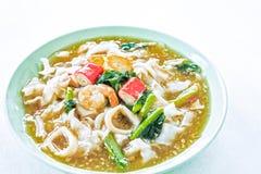 Thai noodles or kuaytio rat na, isolated on white background Royalty Free Stock Photo