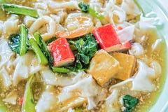Thai noodles or kuaytio rat na, isolated on white background Stock Photo