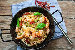 Thai noodles on pan. Thai noodles with vegetables and prawns on pan Stock Image