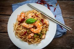 Thai noodles on pan. Thai noodles with vegetables and prawns on plate Royalty Free Stock Image