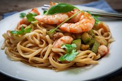 Thai noodles on plate. Thai noodles with vegetables and prawns on plate Royalty Free Stock Photos