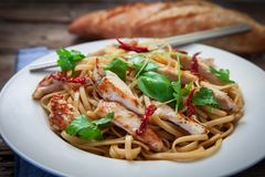 Thai noodles on plate. Thai noodles with vegetables and chicken on plate Royalty Free Stock Photography