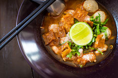 Thai Noodles spicy tom yum soup with pork Stock Photo