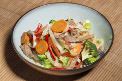 Thai noodles with vegetables and beef in oyster sauce Royalty Free Stock Photos