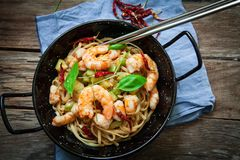 Thai noodles on pan. Thai noodles with vegetables and prawns on pan with oyster sauce Stock Image