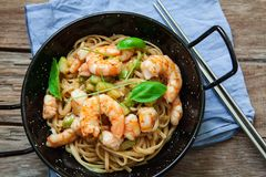 Thai noodles on pan. Thai noodles with vegetables and prawns on pan Royalty Free Stock Images