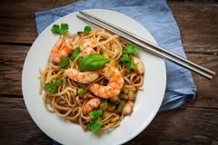 Thai noodles on pan. Thai noodles with vegetables and prawns on plate Royalty Free Stock Images