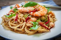 Thai noodles on plate. Thai noodles with vegetables and prawns on plate Stock Photos
