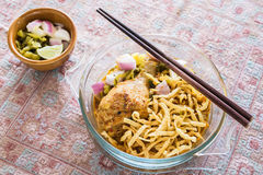 Thai northern curry noodle with chicken in glass bowl royalty free stock photo