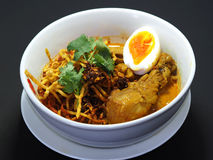 Thai northern food, Crispy noodle with chicken and boiled egg. In curry soup hot chili, Kow Soi Stock Photo