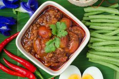 Thai Northern Style Pork and Tomato Chili Relish with sticky ric. E and vegetables on banana leaf, Nam Prik Aawng, Nam Prik Ong, Bruschetta fried with pork, oil Stock Images