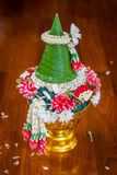 Thai offering dish with banana leaf cone for auspicious ceremony Stock Photos