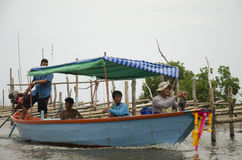 Thai old man riding long tail boat bring people go home after fi Royalty Free Stock Photos