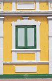 Thai old style classic window in yellow and green Royalty Free Stock Photo