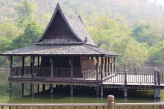 Thai old style wooden pavilion in the pond . Stock Photo