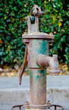 Thai old water pump. Stock Photos