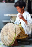 Thai Old woman weaving bamboo baskets Royalty Free Stock Images