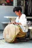 Thai Old woman weaving bamboo baskets Royalty Free Stock Photography