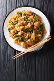 Thai Pad See Ew Noodles With Chicken, Chinese Broccoli And Egg Close-up On A Plate. Vertical Top View Stock Image