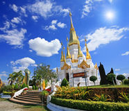 Thai Pagoda against sunbeam and blue sky Royalty Free Stock Image