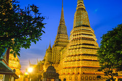 Thai Pagoda art architecture with sunset in Wat Phra Chetupon Vimolmangklararm Wat Pho temple, Thailand Stock Photo