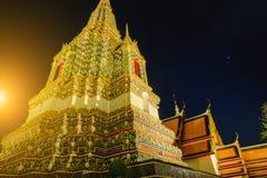 Thai Pagoda art architecture with sunset in Wat Phra Chetupon Vimolmangklararm Wat Pho temple, Thailand Royalty Free Stock Photos