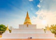 Thai pagoda with sunbeam in the sky. Thai pagoda with sunbeam in sunset sky Royalty Free Stock Image