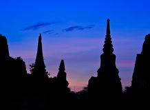 Thai pagoda at sunset Stock Photo