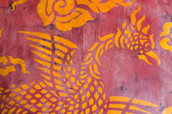Thai paint on the  wall. Gole thai paint on the red wall Stock Photography