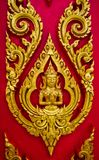 Thai painting carved on a church's door. In the Thai Buddhist te Royalty Free Stock Images
