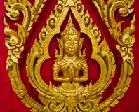 Thai painting carved on a church's door. In the Thai Buddhist te Stock Photo