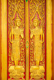 Thai painting craved on churchs door in buddha tha Royalty Free Stock Photography