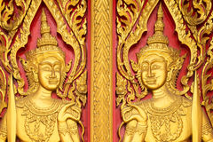 Thai painting craved on church's door in buddha thai temple Royalty Free Stock Photo