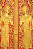 Thai painting craved on church's door in buddha thai temple Royalty Free Stock Images