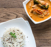 Thai panang curry with bowl of white and wild rice Stock Image