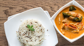 Thai panang curry with bowl of white and wild rice Royalty Free Stock Photos